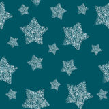 Christmas and New Year`s seamless pattern.Snow stars print on the blue background Stock Image