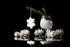 Christmas and New Year`s snow decorations on a black mirror refl Stock Image