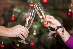 Christmas New Year's toast. On the background of the Christmas tree Royalty Free Stock Photography