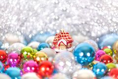 Christmas and New Year`s toy fairy tale red house in snowdrifts and snow of Christmas balls and tinsel in blue and white colors. Holiday decorations, ornaments royalty free stock photography