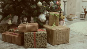 Christmas and New Year's toys on the Christmas tree among the twinkling lights. stock footage