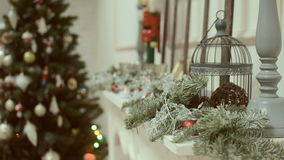Christmas and New Year's toys on the Christmas tree among the twinkling lights. stock video footage