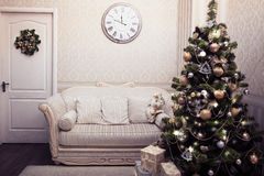 Christmas and New Year scene. With decorated tree, gifts, holiday wreath. Horizontal Stock Images