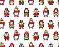 Christmas and new year seamless pattern. Cute cartoon penguins in winter clothes on a white background among snowflakes. Winter