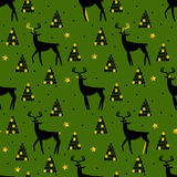 Christmas and New Year seamless pattern with deer, tree and golden elements. Vector background Stock Photo