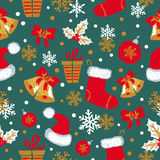 Christmas and New Year seamless pattern with doodle bells, balls, Christmas stockings Royalty Free Stock Images