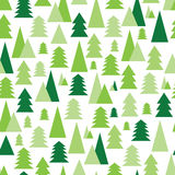 Christmas and New Year seamless pattern with green trees on a wh Royalty Free Stock Image