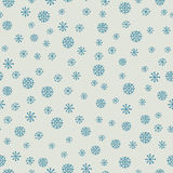 Christmas and New Year seamless pattern with snowflakes. Christmas and New Year seamless pattern with blue snowflakes on a white background. EPS10 vector Royalty Free Stock Photo
