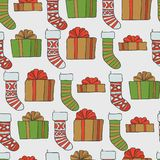 Christmas and new year seamless pattern. Vector holiday background with gifts socks for greeting card design and. Packaging vector illustration