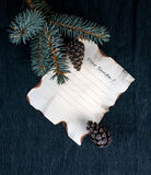 Christmas, new year. a sheet of paper on desk with branch fir tree and cones. inscription Dear Santa. Christmas, new year. a sheet of paper on a desk with a Stock Photos
