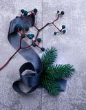 Christmas, new year. silver plate, silk, fur-tree branch, a bunch of grapes. top view Royalty Free Stock Photo