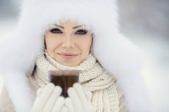 Christmas new year snow winter beautiful girl in white hat nature Stock Photos