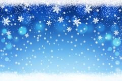 Christmas and New Year snowflakes bokeh background. Winter holiday snow Royalty Free Stock Image