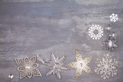 Christmas and New Year snowflakes border or frame on gray background. Winter holidays concept Royalty Free Stock Photography