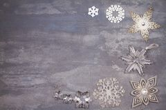 Christmas and New Year snowflakes border or frame on gray background. Winter holidays concept Royalty Free Stock Image