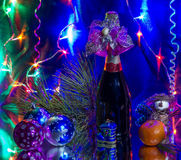 Christmas, New Year. Christmas still life with champagne and Christmas decorations Royalty Free Stock Photography