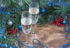 New Year composition, champaign, pine, ornament decoration. Christmas and New Year still life composition with two champaign glasses, pine tree acerose, red royalty free stock photography