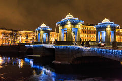 Christmas and New Year street decoration and illumination on bridge at winter night holiday in Saint Petersburg, Russia. Royalty Free Stock Image