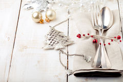 Christmas and New year table place setting with decorations. Stock Photo
