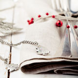 Christmas and New year table place setting with decorations. Royalty Free Stock Image