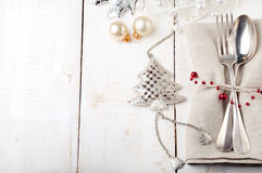 Christmas and New year table place setting with decorations. Royalty Free Stock Photo