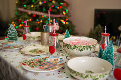 Christmas  and New Year table place setting with empty Christmas plates with festive decorations bauble snowflake star bow ball pi Stock Photos