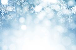 Christmas and New year background. Blue blurred abstract backgro. Christmas and New year theme background. Blue blurred abstract background with snowflake Royalty Free Stock Images
