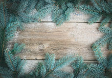 Christmas (New Year) theme background: a frame of fur-tree branc Royalty Free Stock Photo