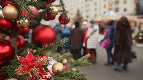 Christmas or New Year theme. Moscow. Christmas tree decorated with beautiful red balls in the foreground. Nearby walking stock video footage