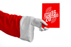 Christmas and New Year 2016 theme: Santa Claus hand holding a red gift card on a white background in studio isolated Stock Photography