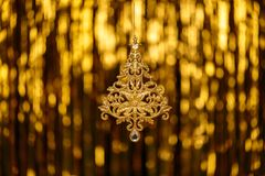 Christmas New Year Toy Fir on Gold Blur Royalty Free Stock Photos