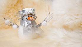 Christmas (New Year) card: toy snowman on white sheep fur background Stock Images