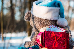 Christmas and new year. Toys teddy bear in the wood royalty free stock photos
