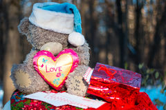 Christmas and new year. Toys teddy bear in the wood royalty free stock photo