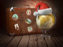 Christmas or new year travel concept. Old suitcase with globe na. D santa hat on wood background. 3d illustration stock illustration