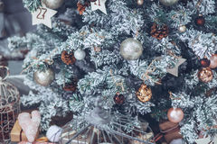 Christmas and New Year Tree decorated close up. Christmas presen. T on white wooden background in vintage style Royalty Free Stock Photo