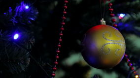 Christmas and New Year tree decoration, garland and toys. Light is turned on and off. Tree Lights Twinkling. Holiday concept stock video