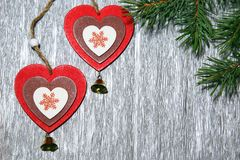 Christmas, New Year. Two multicolored hearts on a brilliant, sil Stock Images