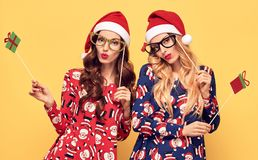 New Year. Woman in Santa hat with Christmas Props Stock Photos