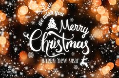 Christmas and New Year Typographical on dark bokeh background with snow and light. Xmas and Happy New Year theme. Flat lay, top view royalty free illustration