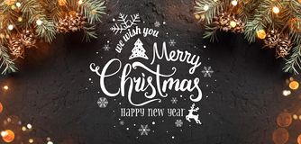 Christmas and New Year Typographical on dark holiday background with frame of Fir branches, pine cones. Xmas and Happy New Year theme, bokeh, sparking, glowing stock illustration