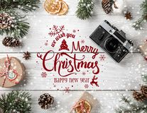 Christmas and New Year Typographical on white wooden background with Fir branches, gifts, camera. Xmas and Happy New Year theme. Snow. Flat lay, top view stock illustration