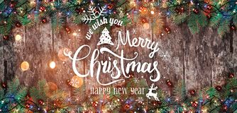 Christmas and New Year Typographical on wooden background with Fir branches. Xmas and Happy New Year theme. Flat lay, top view, copy space, wide composition stock images
