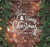 Christmas and New Year Typographical on wooden background with Fir branches. Xmas and Happy New Year theme. Flat lay, top view, copy space, wide composition royalty free stock photography