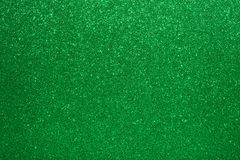 Christmas New Year Valentine Day Green Glitter background. Holiday abstract texture fabric. Element, flash. Holiday abstract texture fabric. Element, flash royalty free stock image