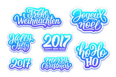 Christmas and New Year vector labels set. Merry Christmas and Happy New Year 2017 vector blue labels set with english, french and german greetings text. Holly Stock Photography