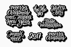 Christmas and New Year vector labels set. Merry Christmas and Happy New Year 2017 vector labels set with english, french and german greetings text. Holly jolly Royalty Free Stock Photos