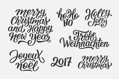 Christmas and New Year vector lettering set. Merry Christmas and Happy New Year 2017 vector lettering set with french, english and german greetings. Holly Jolly Royalty Free Stock Image
