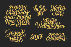 Christmas and New Year vector lettering set. Merry Christmas and Happy New Year 2017 vector golden lettering set on black with french, english and german Stock Photography