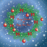 Christmas and New Year vintage greeting cards with holiday symbol wreath on blue snowing sky background Stock Photography